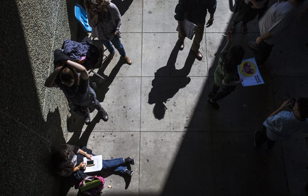 Hundreds of people wait in line for a chance to hear Senator Bernie Sanders speak during a rally held to celebrate free community college tuition for San Francisco residents at City College of San Francisco Friday, September 22, 2017. (Jessica Christian/S.F. Examiner)