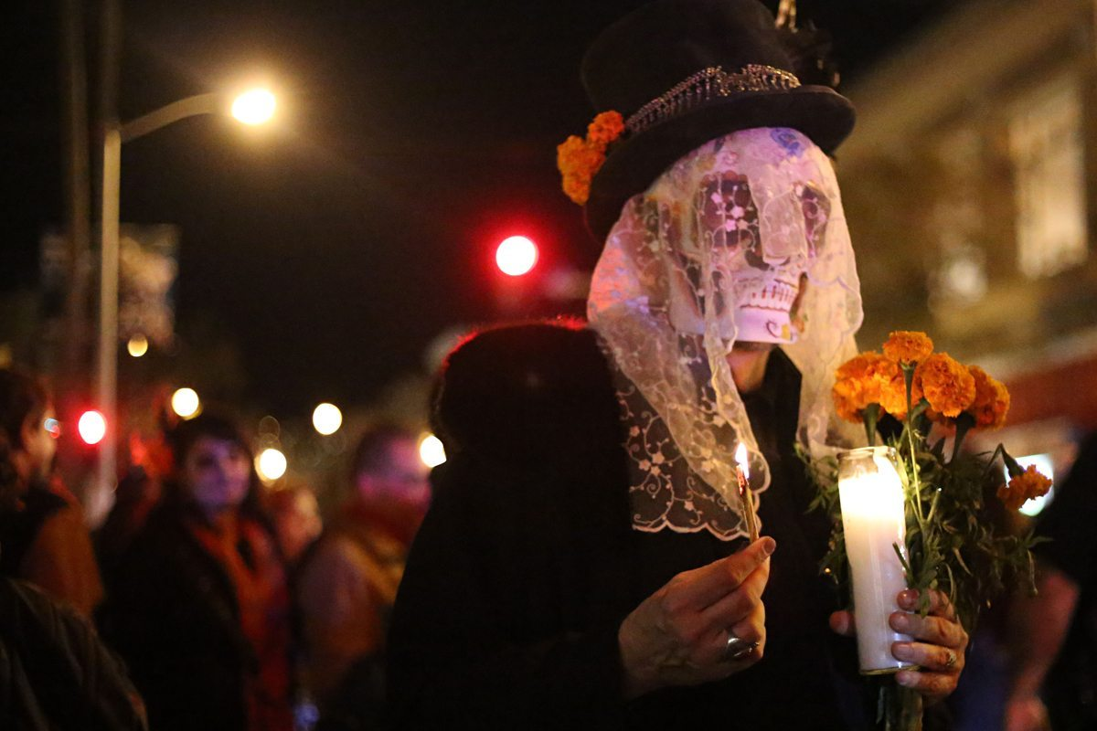 A man stands int eh crowd at the Dia De Los Muertos procession in San Francisco's Mission District on Wednesday November 2, 2016. Aleah Fajardo/ Special To S.F. Examiner