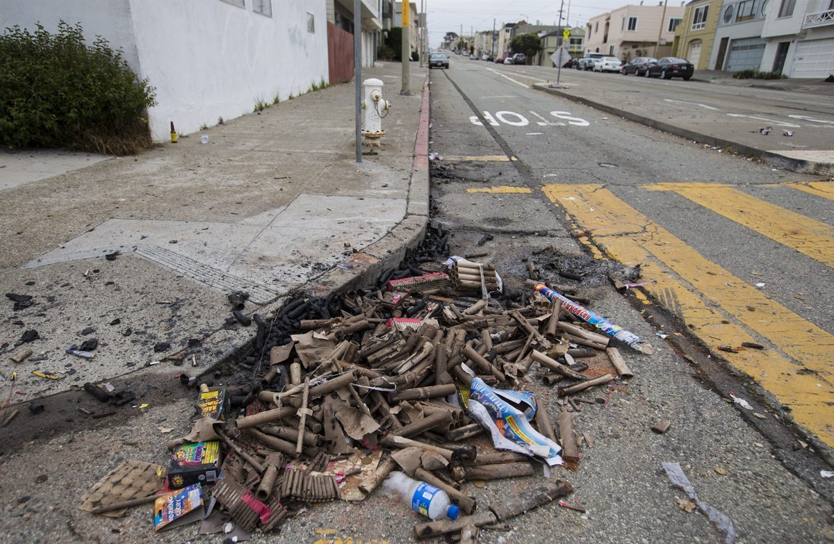 A large pile of fireworks debris is seen gathered on the corner of 43rd Avenue and Judah Street in San Francisco's Outer Sunset neighborhood Wednesday, July 5, 2017. (Jessica Christian/S.F. Examiner)