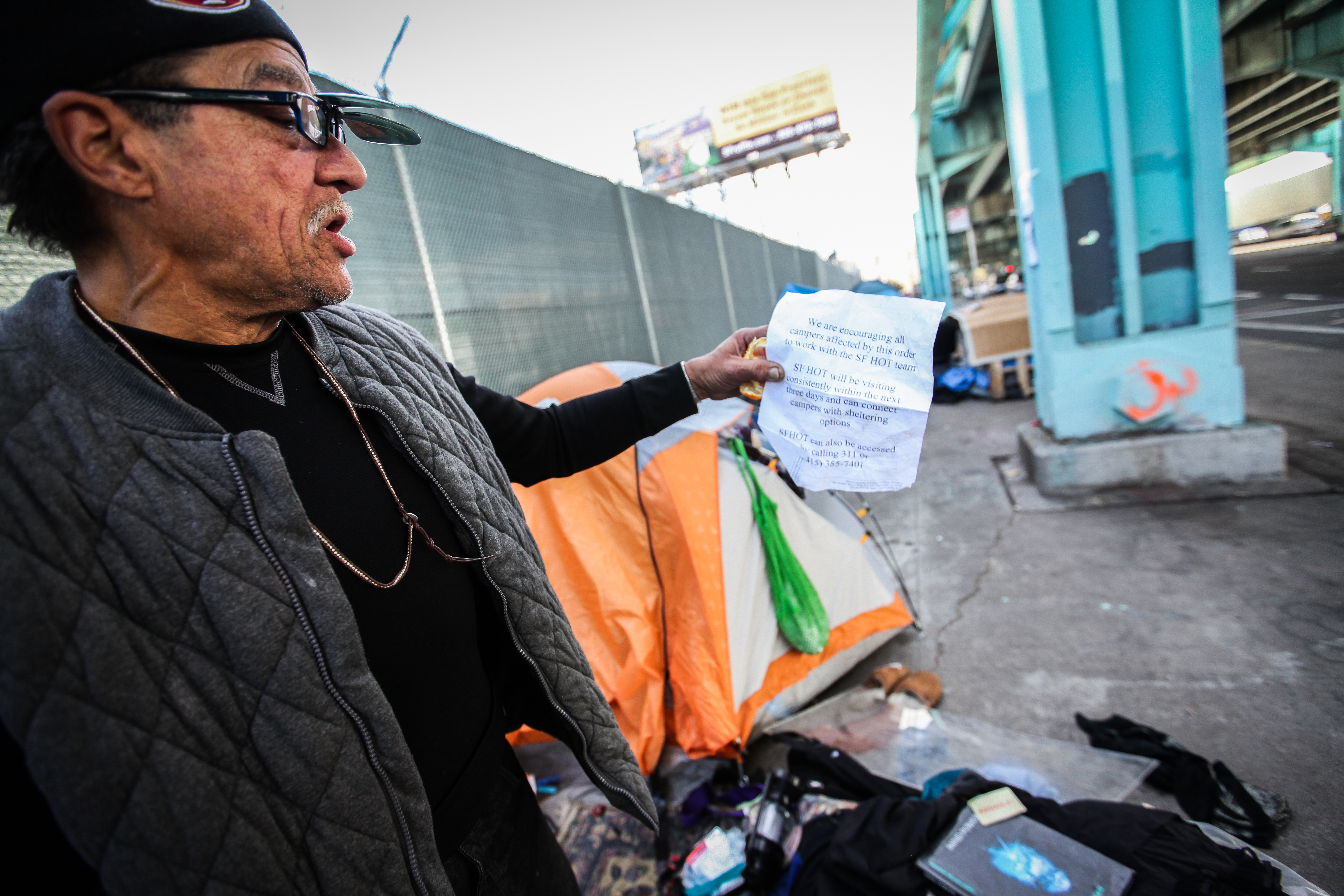 A homeless man Larry Muraoka, 67, holds the back side of Abatement order to vacate notice he received from Department of Public Health. The notice ordered all homeless encampment tent owners to vacate the area by Friday, February 26. A former barber for 17 years and 4 years worked as a fireman, Muraoka is now living in a tent near 13th and Division streets for 4-5 months long and today he plans to move his tent and leave the area at 6 p.m. Thursday, February 25, 2016. (Ekevara Kitpowsong/ Special to S.F. Examiner)