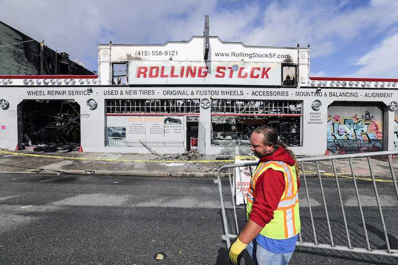 A three-alarm fire on Sunday morning in the Inner Mission neighborhood of San Francisco destroyed an auto business and displaced 17 people at an apartment building. (Mike Koozmin/S.F. Examiner)