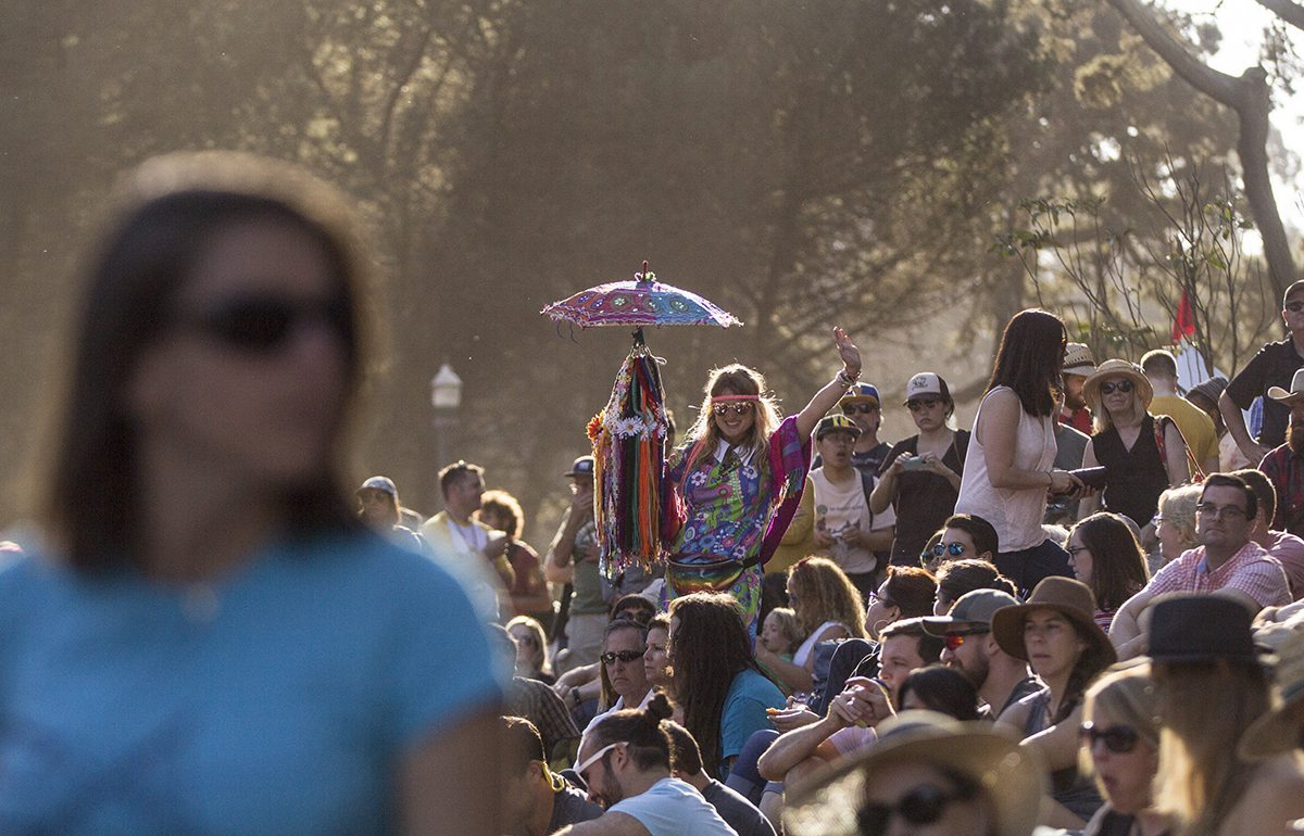 A woman makes her way through the crowd near the Rooster Stage during the first day of Hardly Strictly Bluegrass Festival Frida, October 5, 2017. (Jessica Christian/S.F. Examiner)