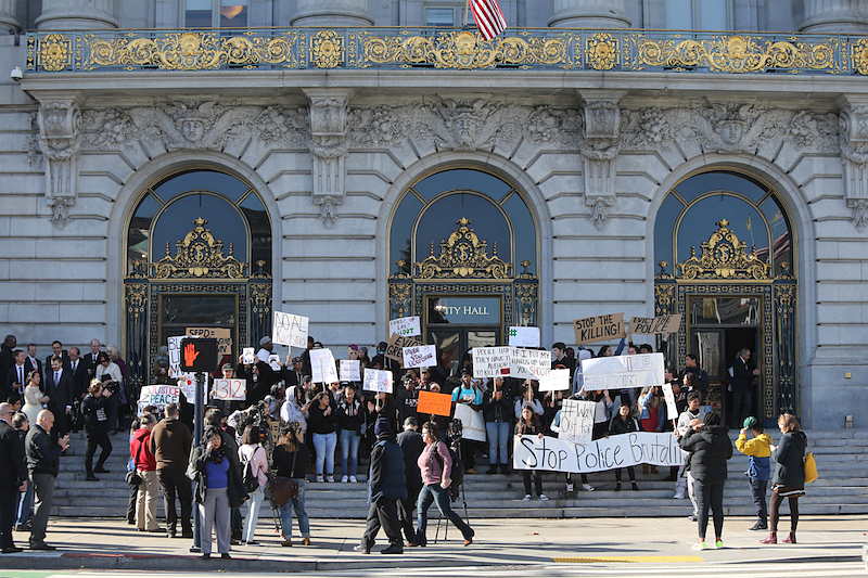 Students in San Francisco walked out of school and gathered on the steps of city hall Friday, December 11, 2015, to bring awareness to the issues of police brutality and the recent killing of Mario Woods by officers in the Bayview district. (Mike Koozmin/S.F. Examiner)