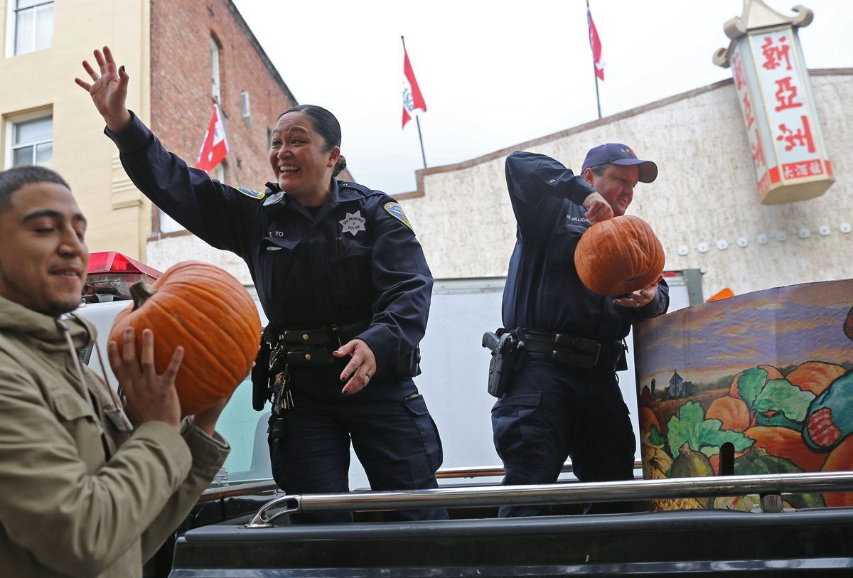 SFPD officers bring free pumpkins for residents at the Ping Yuen Center in San Francisco, Calif on Friday October 28, 2016. Aleah Fajardo/ Special To S.F. Examiner