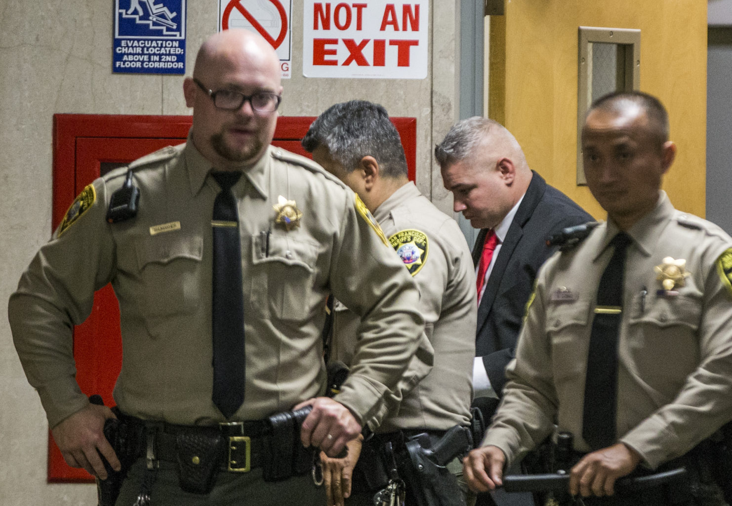 Bureau of Land Management Ranger John Woychowski is surrounded by sheriff's deputies as he enters the courtroom during the fourth day of trial in the case against Jose Ines Garcia Zarate for the 2015 killing of 32-year-old Kathryn Steinle at the Hall of Justice in San Francisco, Calif. Thursday, October 26, 2017. (Jessica Christian/S.F. Examiner)