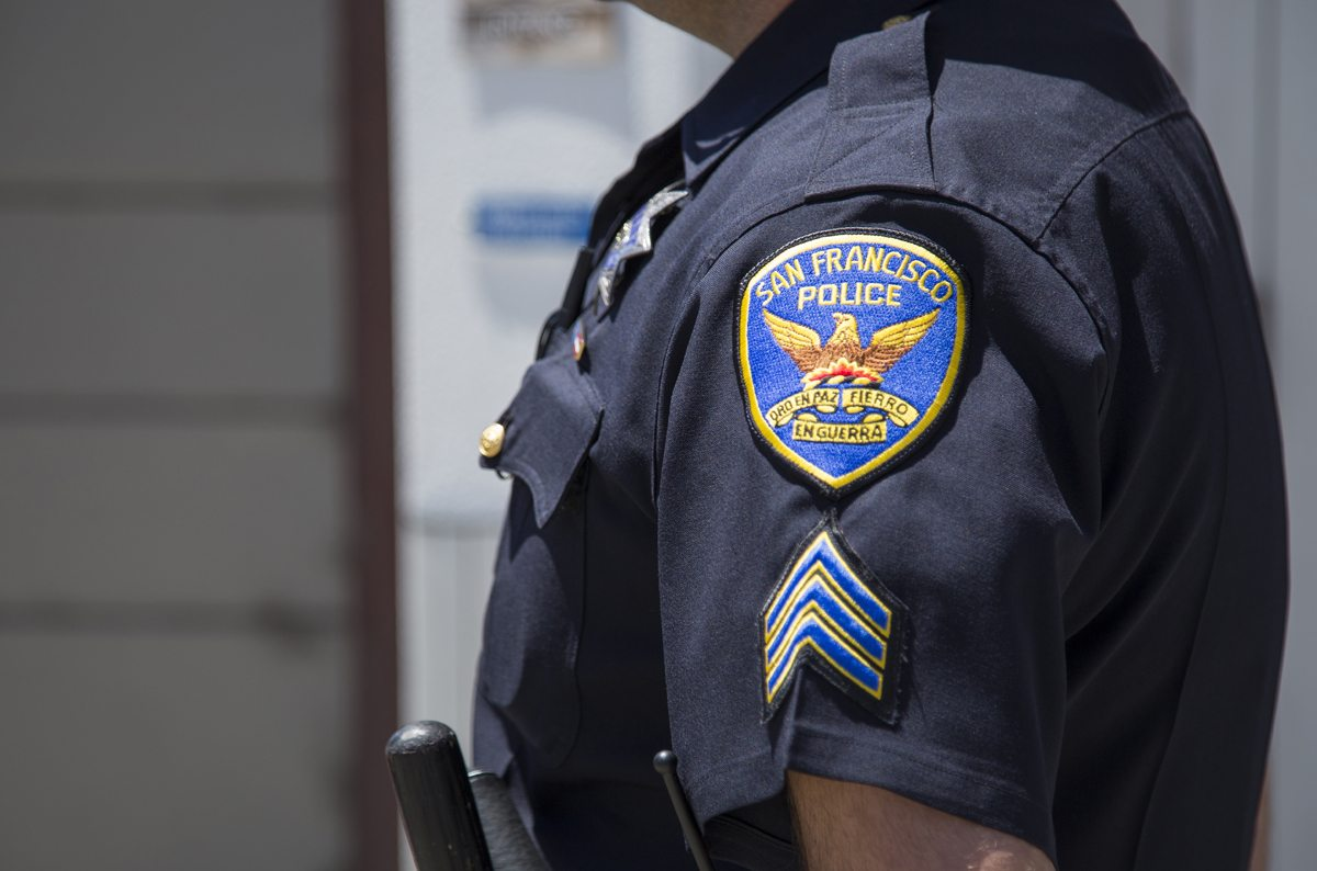 An officer stands outside the Bayview Police Station during a rally in San Francisco, Calif. Thursday, June 2, 2016. (Rachael Garner/Special to S.F. Examiner)