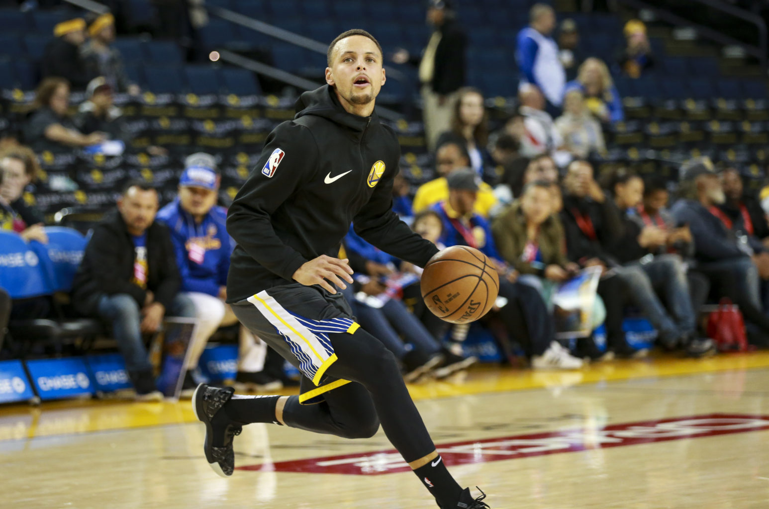 Stephen Curry (30) of the Golden State Warriors takes some practice shots despite being injured with a groin strain and having been involved in a morning car accident on Highway 24 on November 23, 2018 at Oracle Arena in Oakland, California. (Chris Victorio - Special to S.F. Examiner)