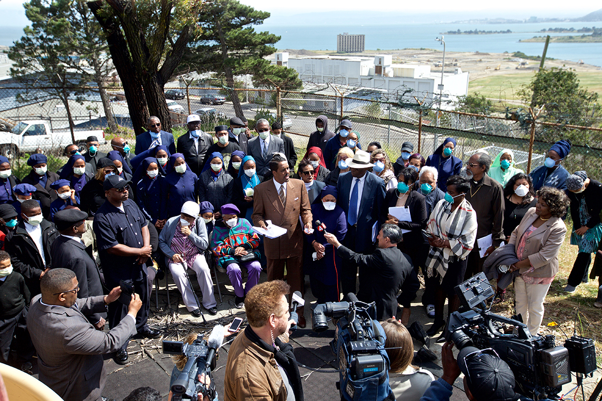 Minister Christopher Muhammad speaks during a press conference at the Nation of Islam school playground overlooking the Hunters Point Shipyard to announce the filing of a $27.3 billion lawsuit on behalf of Bayview residents. The lawsuit alleges residents were misled about the toxic cleanup of the shipyard site on Tuesday, May 1, 2018. (Kevin N. Hume/S.F. Examiner)
