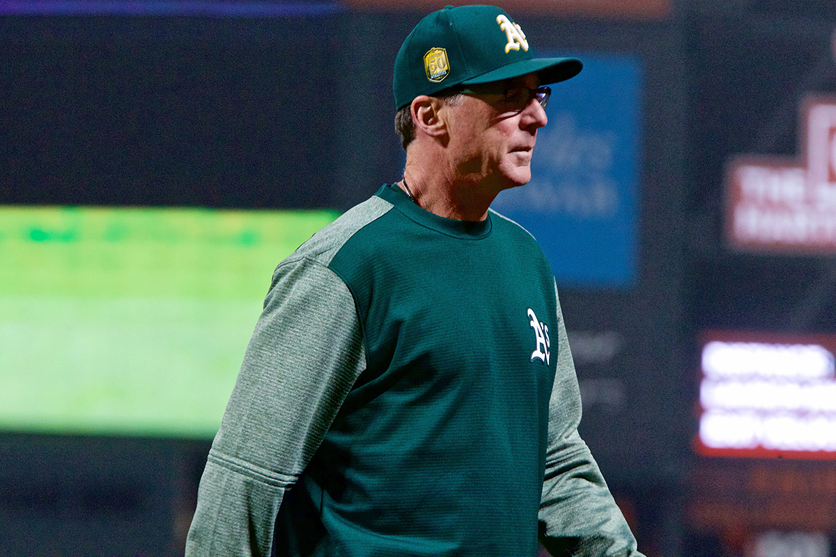 Oakland Athletics' manager Bob Melvin heads back to the dugout after making a pitching change against the Giants at AT&T Park on Friday, July 13, 2018. (Kevin N. Hume/S.F. Examiner)