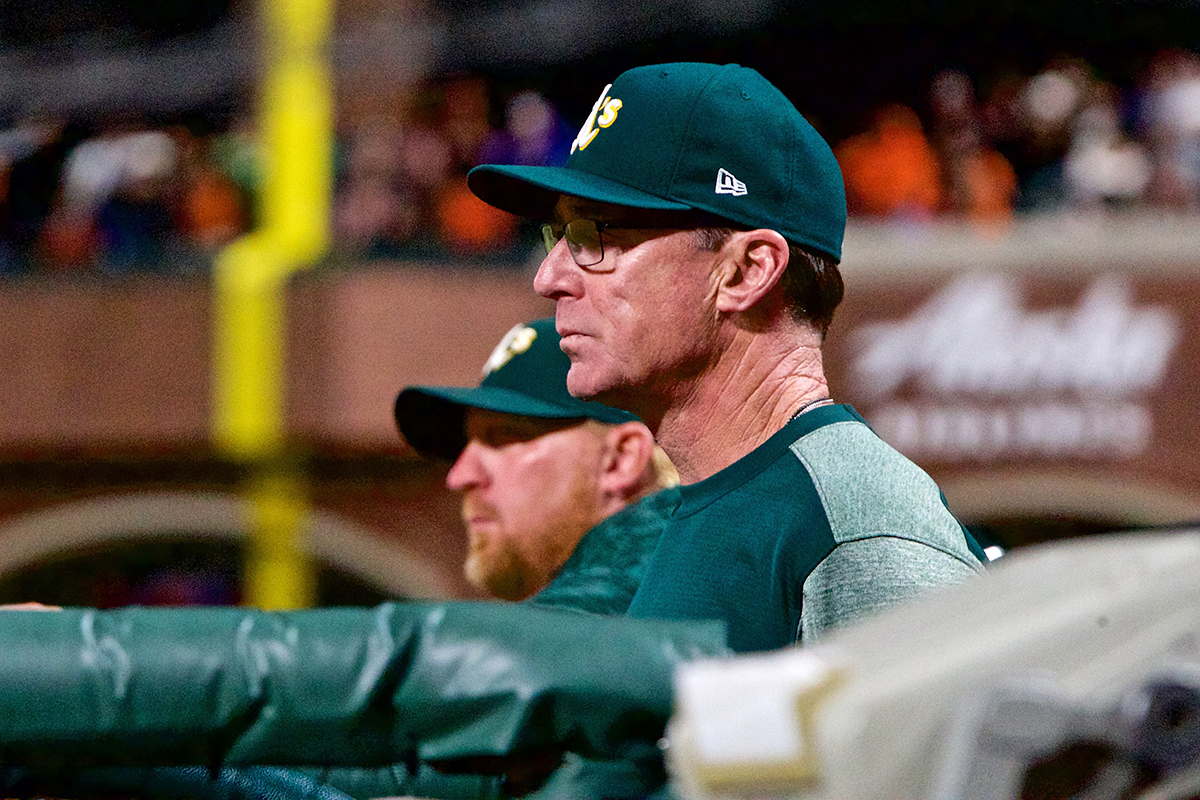 Oakland Athletics' manager Bob Melvin watches the game in the dugout against the Giants at AT&T Park on Friday, July 13, 2018. (Kevin N. Hume/S.F. Examiner)