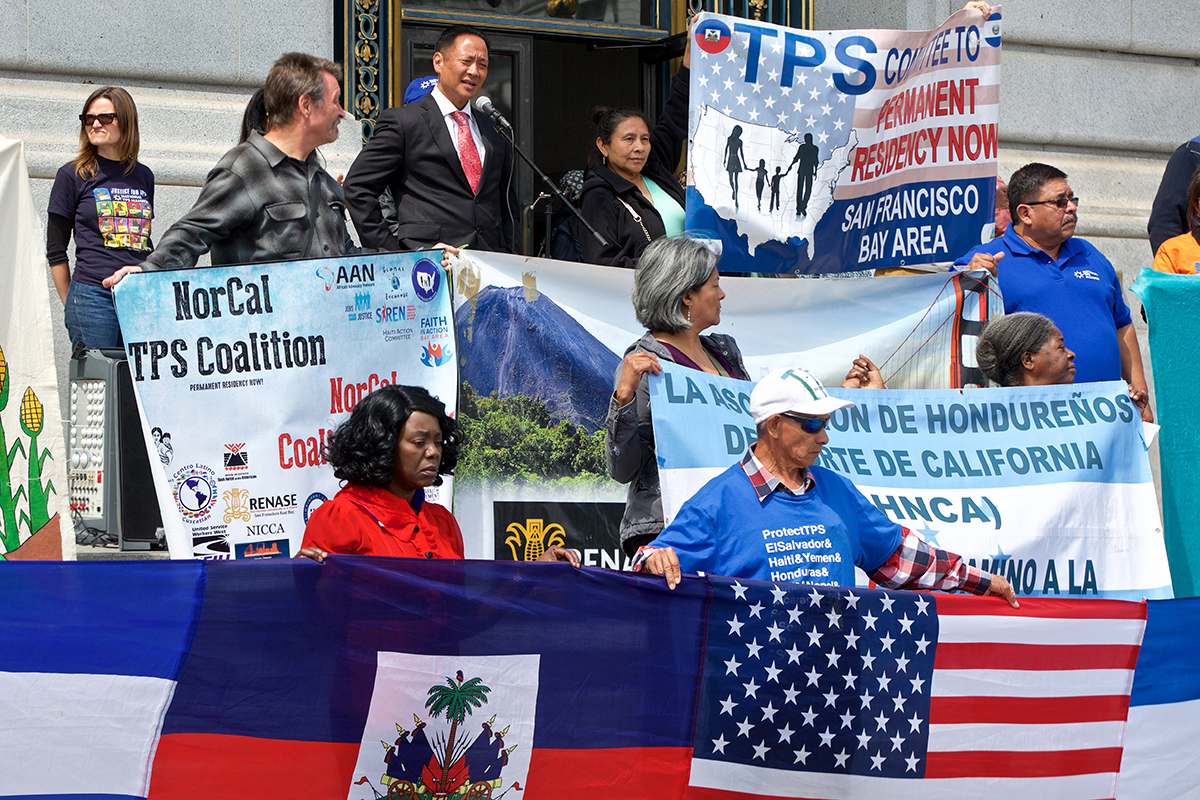 "SF Public Defender Jeff Adachi speaks during a rally at City Hall organized by the National Temporary Protected Status Alliance that is part of the ""TPS Journey for Justice"" bus tour across the country on Monday, Aug. 27, 2018. (Kevin N. Hume/S.F. Examiner)"