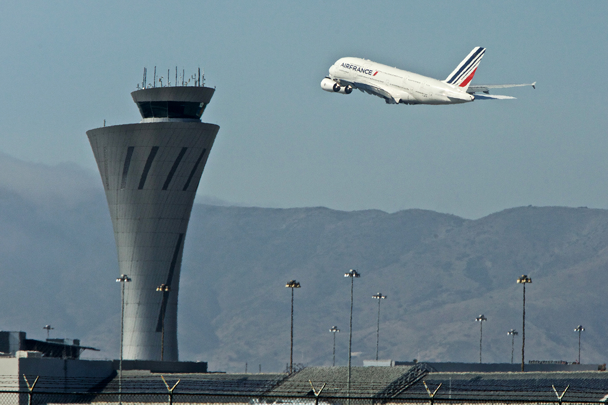 An Air France Airbus A380 heads past the control tower shortly after take off at San Francisco International Airport on Tuesday, Sept. 4, 2018. (Kevin N. Hume/S.F. Examiner)