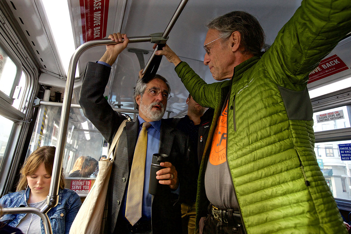Supervisor Aaron Peskin chats with Peter Strauss with the SF Transit Riders as they ride the 47 Muni bus along Van Ness Avenue to kick off Transit Week in The City on Monday, Sept. 24, 2018. (Kevin N. Hume/S.F. Examiner)