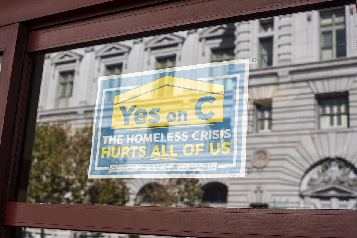 A Yes on C campaign sign is displayed in a window along Mission Street near the U.S. Court of Appeals on Tuesday, Oct. 30, 2018. (DavÌd RodrÌguez/Special to S.F. Examiner)