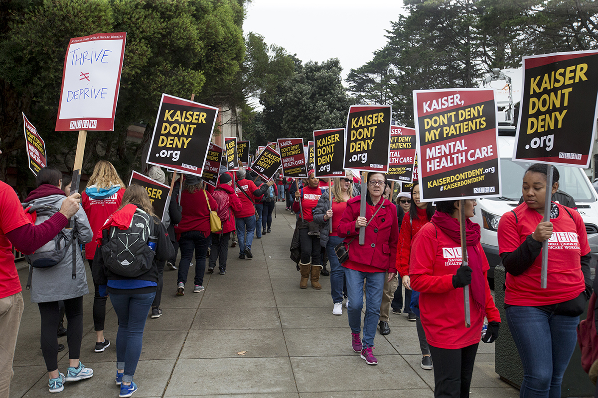 Kaiser employees with the National Union of Healthcare Workers picket outside the Kaiser San Francisco Medical Center on day one of a five-day planned strike on Monday, Dec. 10, 2018. (Kevin N. Hume/SF Examiner)