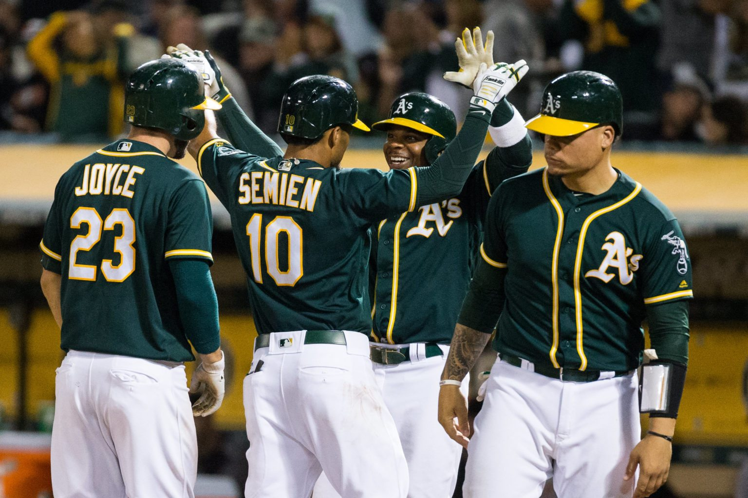 The Oakland Athletics celebrate Oakland Athletics shortstop Marcus Semien (10) hitting a grand slam home run against the San Francisco Giants at Oakland Coliseum in Oakland, California, on July 31, 2017. (Stan Olszewski/Special to S.F. Examiner)