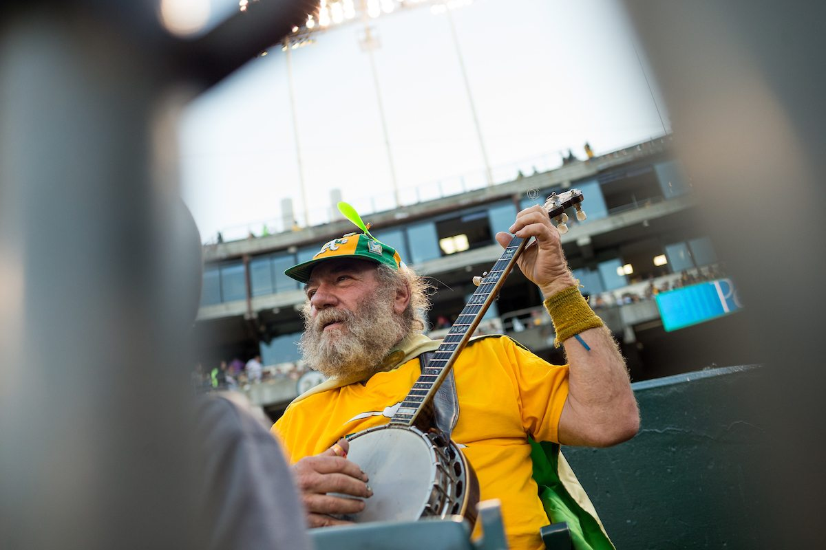 Banjo Man Stacy Samuels watches the Oakland Athletics host the San Francisco Giants at Oakland Coliseum in Oakland, California, on July 31, 2017. (Stan Olszewski/Special to S.F. Examiner)
