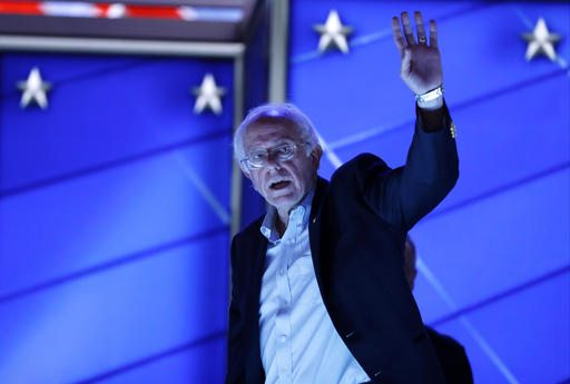 Sen. Bernie Sanders, I-Vt., waves as he walks off the stage after checking out the podium before the start of the first day of the Democratic National Convention in Philadelphia on Monday. (AP Photo/Carolyn Kaster)