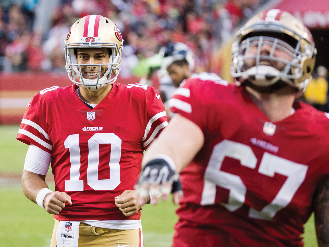 Jimmy Garoppolo and Daniel Kilgore celebrate the 49ers' last-second touchdown that ensured they lost by only 11 points. (Stan Olszewski/Special to S.F. Examiner)