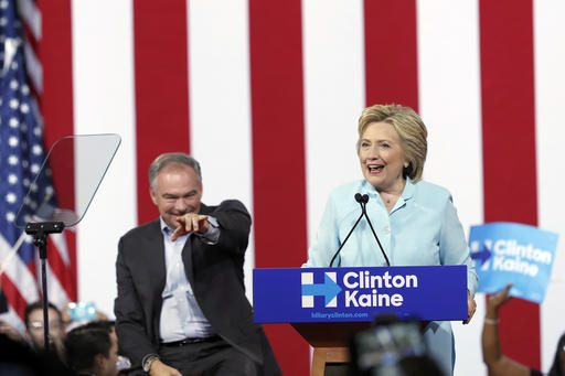 In this July 23 photo, Democratic presidential candidate Hillary Clinton, accompanied by her running mate, Democratic Vice Presidential candidate Sen. Tim Kaine, D-Va., speaks at a rally in Miami. (AP Photo/Mary Altaffer, File)