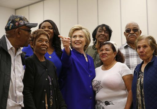 Democratic presidential candidate Hillary Clinton, center, visits a community center, Monday in Compton. (AP Photo/John Locher)