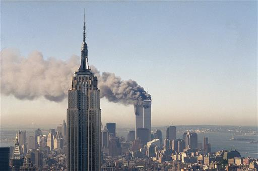 "In this Sept. 11, 2001 file photo the twin towers of the World Trade Center burn behind the Empire State Building in New York after terrorists crashed two planes into the towers causing both to collapse. The government is preparing to release a once-classified chapter of a congressional report about the attacks of Sept. 11, that questions whether Saudi nationals who helped the hijackers with things like finding apartments and opening bank accounts knew what they were planning. House Minority Leader Nancy Pelosi said Friday July 15, 2016, that the release of the 28-page chapter is ""imminent."" (AP Photo/Marty Lederhandler)"