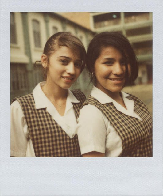 "Matt O'Brien captures everyday life in Colombia -- such as ""School girls, Medellín, 2010"" -- in his photography show at the Colombian Consulate in San Francisco. (Courtesy Matt O'Brien, ""No Dar Papaya""]"