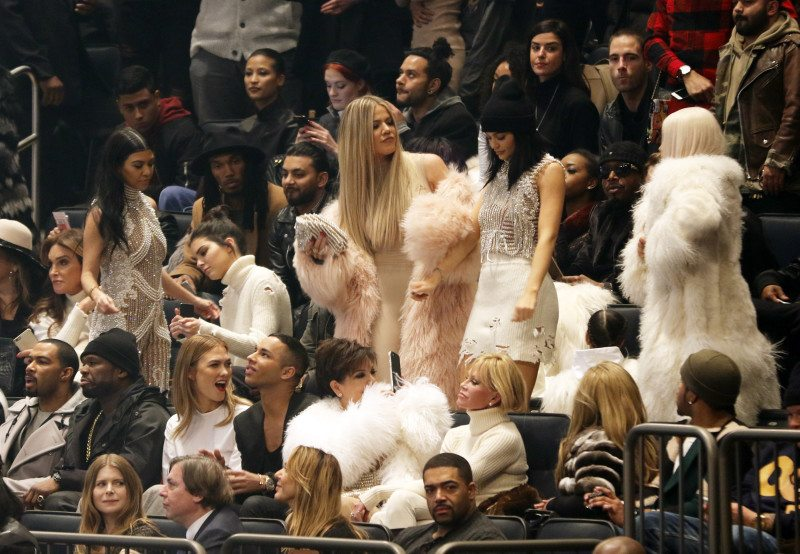 Caitlyn Jenner, second row from left, Kourtney Kardashian, Kendall Jenner, Khloe Kardashian, Kylie Jenner and Kim Kardashian West were out in force at Kanye West's Yeezy presentation and album release in New York. (Bruce Barton/AP)