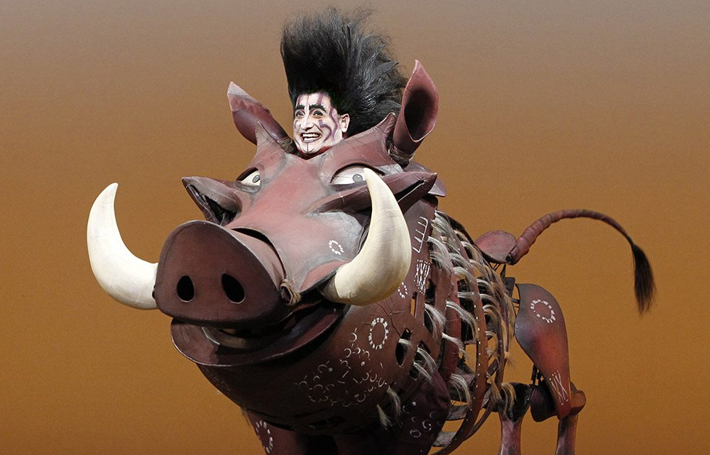 "Ben Lipitz plays the beloved warthog Pumbaa in ""The Lion King."" (Courtesy Joan Marcus)"