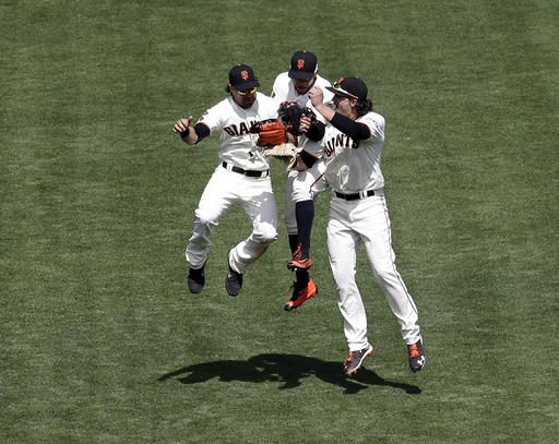 The Giants went with a new-look outfield on Wednesday and still manhandled the Brewers. (Marcio Jose Sanchez/AP)