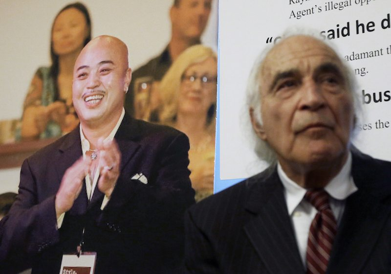 "Tony Serra, right, an attorney for Raymond ""Shrimp Boy"" Chow, pictured at left, listens to speakers at a news conference in San Francisco. (AP Photo/Jeff Chiu, File 2014)"