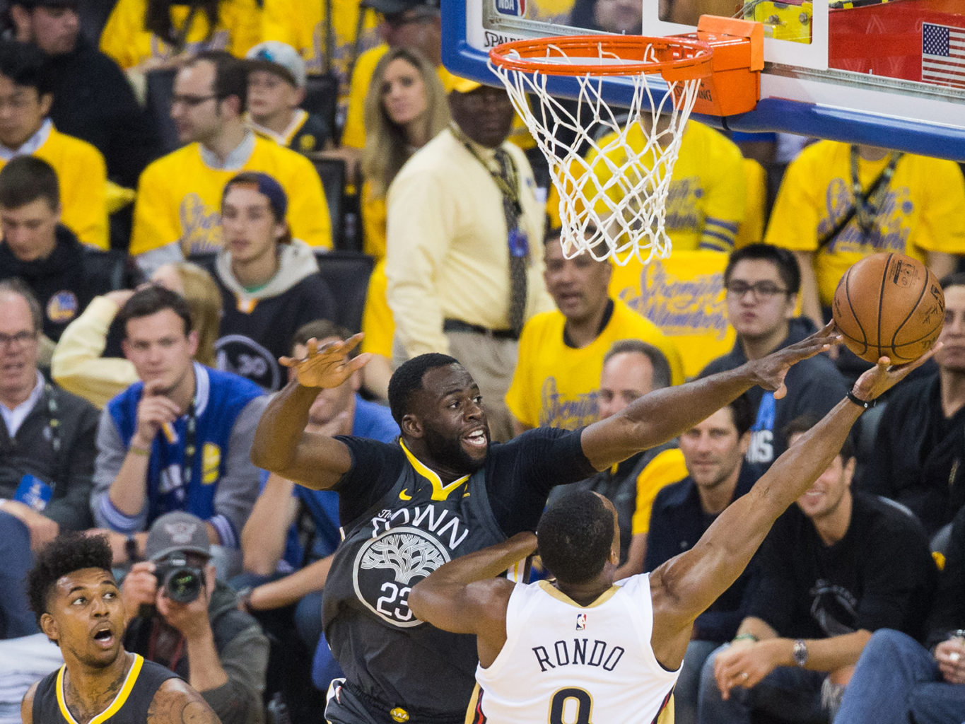 Golden State Warriors forward Draymond Green (23) attempts to block a shot by New Orleans Pelicans guard Rajon Rondo (9) at Oracle Arena during Game 2 of the Western Semifinals in Oakland, California, on May 1, 2018. (Stan Olszewski/Special to S.F. Examiner)