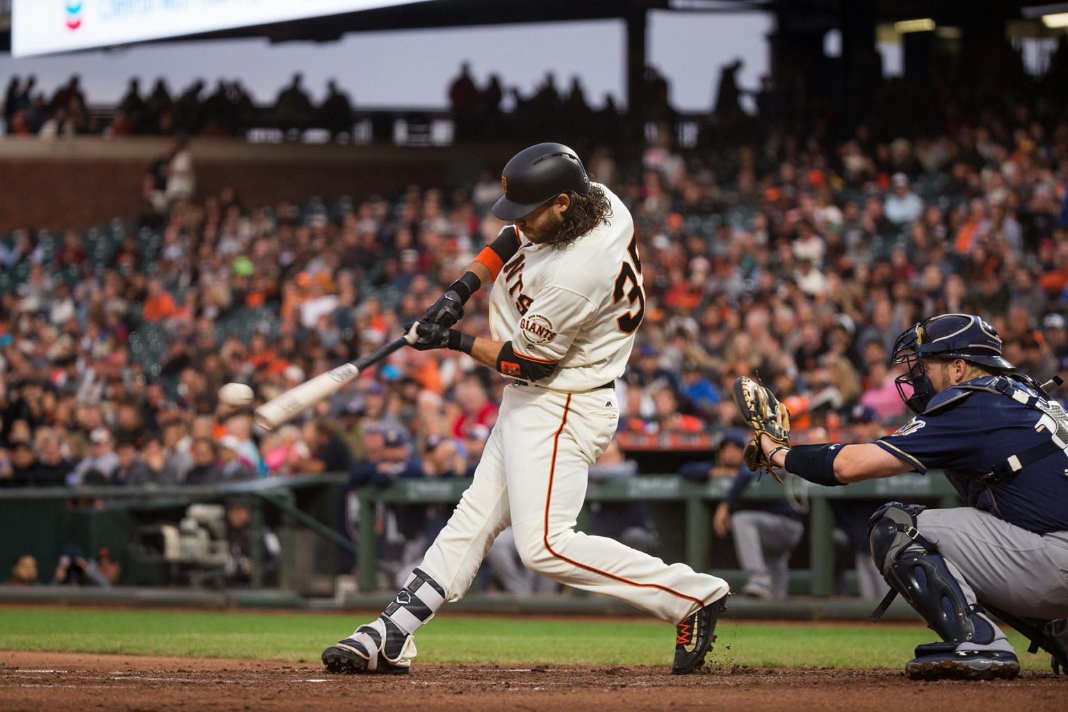 San Francisco Giants shortstop Brandon Crawford (35) hits a foul ball against the Milwaukee Brewers at AT&T Park in San Francisco, California, on August 21, 2017. (Stan Olszewski/Special to S.F. Examiner)