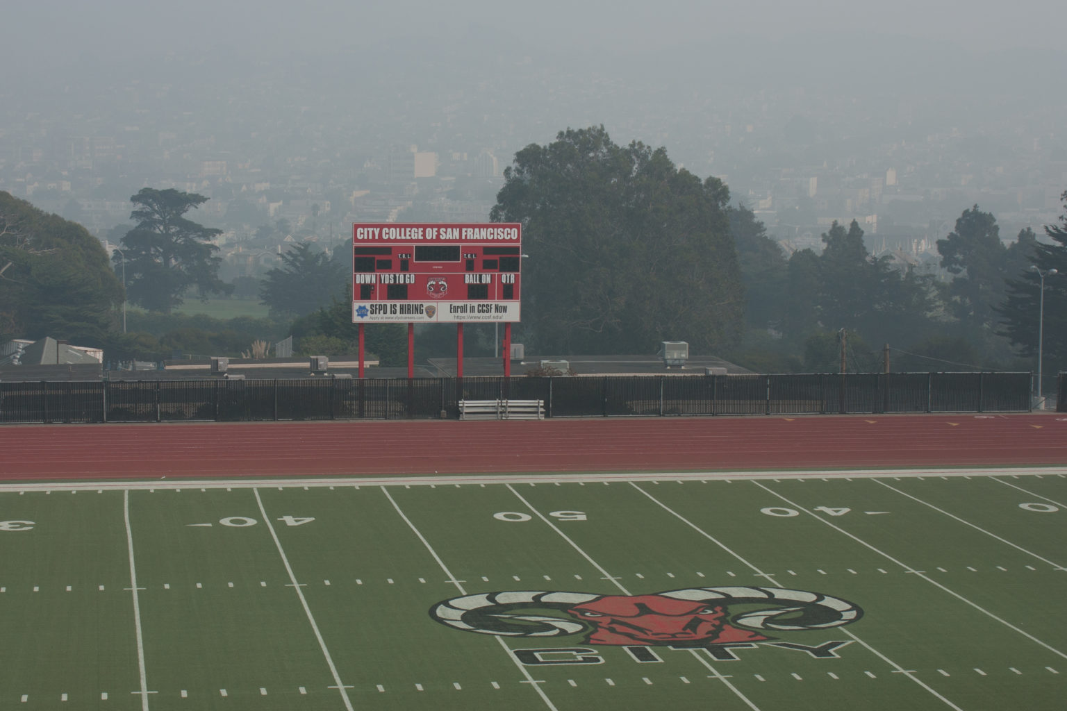 The George Rush Stadium remains nearly empty on Friday, Nov. 16, at City College of San Francisco, a day after the college closed due to compromised air quality. (David Mamaril Horowitz / Special to S.F. Examiner)