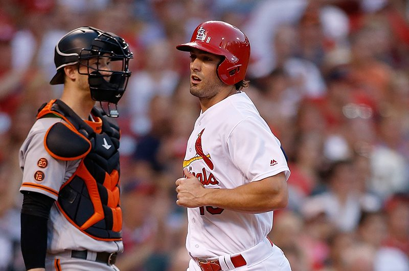 San Francisco Giants catcher Trevor Brown, left, looks on as St. Louis Cardinals' Randal Grichuk scores a run on a RBI single by Matt Carpenter during the third inning of a baseball game, Sunday, June 5, 2016 in St. Louis. (Scott Kane/AP)