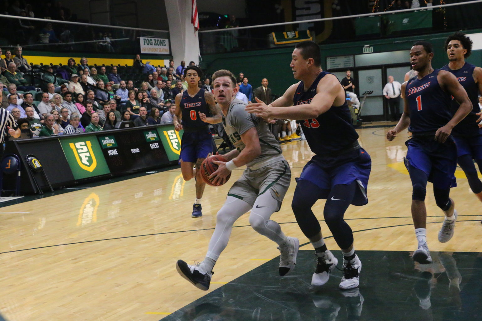 San Francisco guard Frankie Ferrari drives towards the basket in the first half of the Dons' 68-54 win over Cal State Fullerton on Dec. 16, 2018 at War Memorial Gym in San Francisco. (Ryan Gorcey / S.F. Examiner)