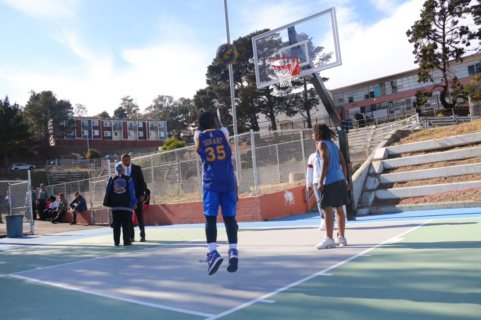 Amahje Emenike (left), 9, and Rahmore Sims, 11, play basketball at the new basketball courts on the new courts at Hunters Point Community Youth Park, made possible by the Good Tidings Foundation, Hope SF, the San Francisco Foundation and the Kevin Durant Charity Foundation. (Ryan Gorcey / S.F. Examiner)