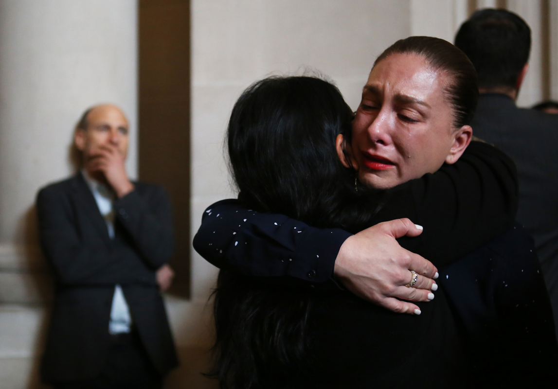 A person cries while embracing another person after a news conference at San Francisco City Hall following the death of Mayor Ed Lee on Tuesday, December 12th, 2017. (Mira Laing/Special to S.F. Examiner)