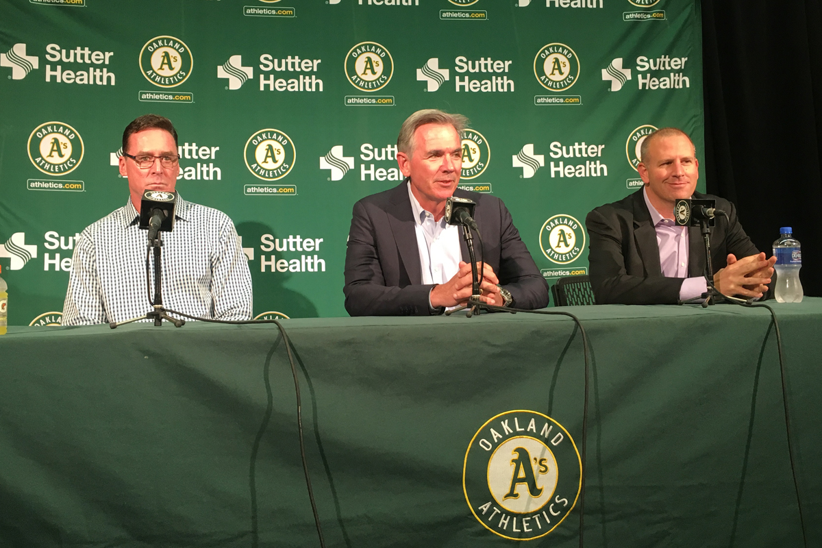 Oakland A's manager Bob Melvin (left), executive vice president of baseball operations Billy Beane (middle) and general manager David Forst (right) announce their contract extensions on Oct. 29, 2018. (Ryan Gorcey / S.F. Examiner)