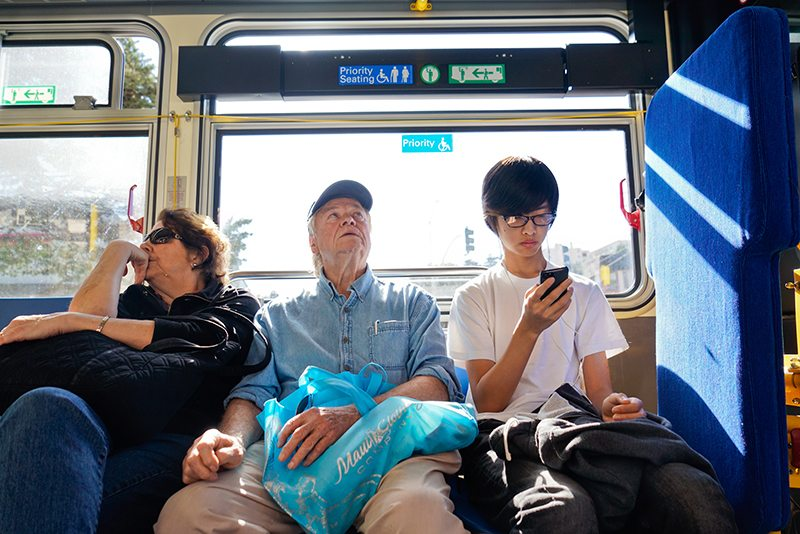 A couple sit next to a young man on the 38r Geary bus outbound to the Richmond district on Monday, Feb. 15, 2016. Youths who don't give up their priority seat to elderly or handicapped passengers face criminal penalties and fees up to $380 (Yesica Prado/Special to the San Francisco Examiner)