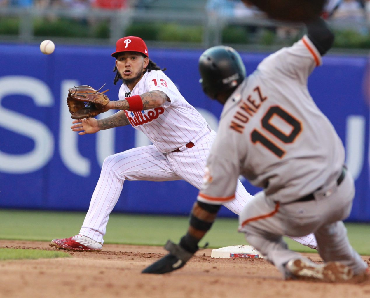 Philadelphia Phillies shortstop Freddy Galvis, left, takes the throw as the San Francisco Giants' Eduardo Nunez is forced out at second base in the second inning at Citizens Bank Park in Philadelphia on Friday, June 2, 2017. The Giants won, 10-0. (Charles Fox/Philadelphia Inquirer/TNS)