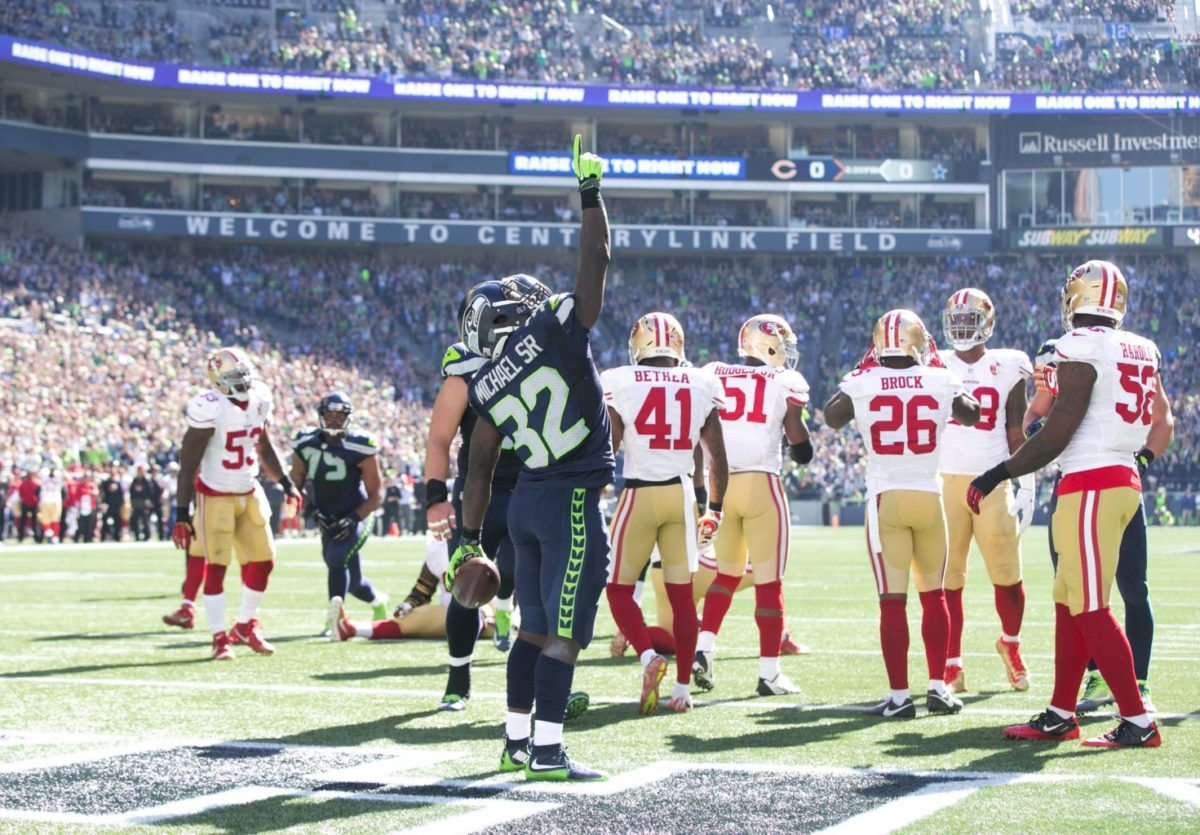 Christine Michael celebrates his second touchdown in the first quarter as the Seattle Seahawks drubbed the San Francisco 49ers on Sunday. (Bettina Hansen/Seattle Times/TNS)