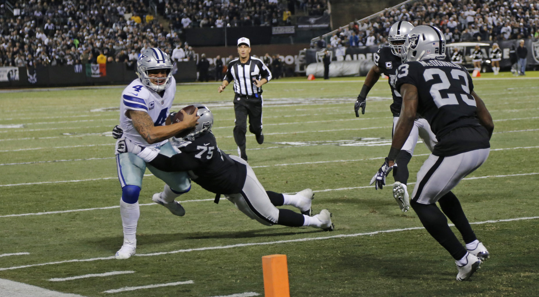 Dallas Cowboys quarterback Dak Prescott (4) scrambles to the four yard line as he cannot find a receiver in the second quarter against the Oakland Raiders on Sunday, Dec. 17, 2017 at Oakland-Alameda County Coliseum in Oakland, Calif. (Rodger Mallison/Fort Worth Star-Telegram/TNS)