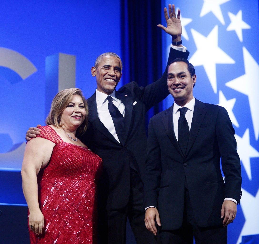 President Obama, flanked by Rep. Linda Sanchez, D-Calif., Chair of the Congressional Hispanic Caucus, and HUD Secretary Julian Castro, waves from the stage at the Congressional Hispanic Caucus Institute's 38th Anniversary Awards Gala at the Washington Convention Center on Thursday, Oct. 8, 2015, in Washington, D.C. (Olivier Douliery/Abaca Press/TNS)