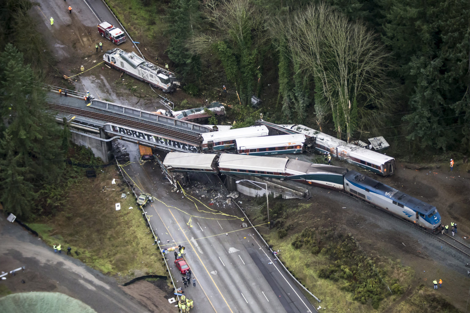 An Amtrak train derailed and fell off of a bridge and onto Interstate 5 near Mounts Road between Lakewood and Olympia, Wash. on Monday, Dec. 18, 2017. (Bettina Hansen/Seattle Times/TNS)