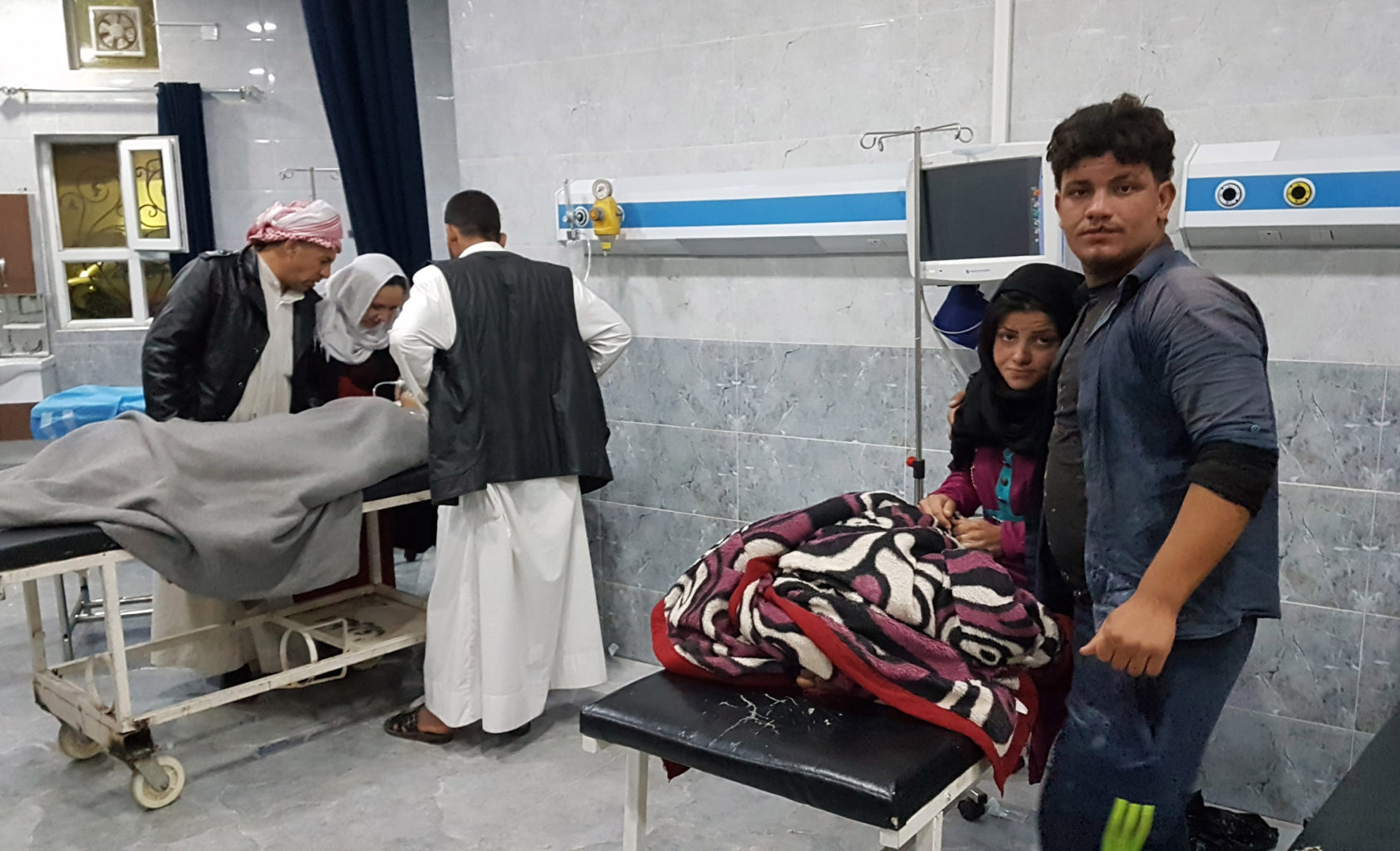 Injured people receive medical treatment in a hospital in Kirkuk, Iraq, on Sunday after an earthquake measuring 7.2 magnitude hit Iraq's northern province of Sulaimaniyah. (Xinhua/Raizer Zangana/Sipa USA/TNS)