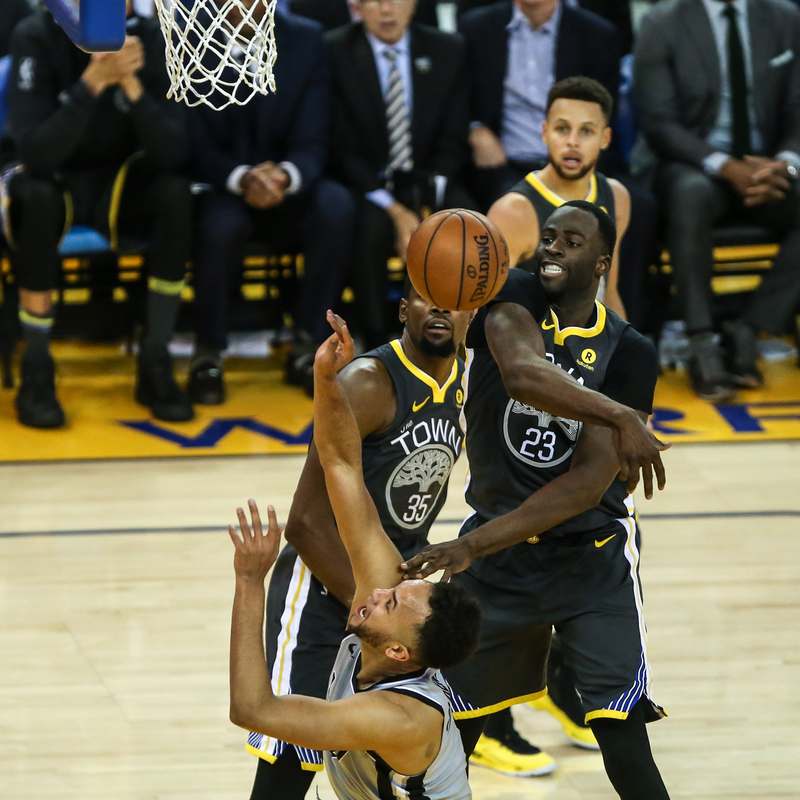 Golden State Warriors forward Kevin Durant (35) and forward Draymond Green (23) block San Antonio Spurs forward Kyle Anderson (1) during the second quarter of an NBA basketball game at Oracle Arena in Oakland, Calif., Saturday, Feb. 10, 2018. (Photo by Joel Angel Juarez / Special to S.F. Examiner)
