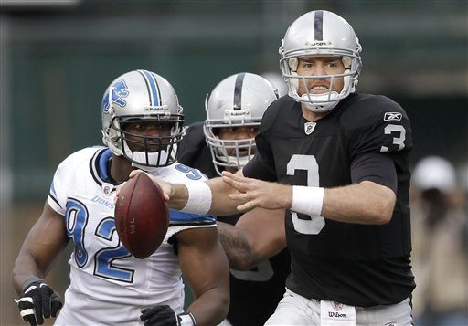 AP Photo/Paul SakumaOakland Raiders quarterback Carson Palmer (3) looks to pass as Detroit Lions defensive end Cliff Avril (92) pursues during the second quarter of an NFL football game in Oakland