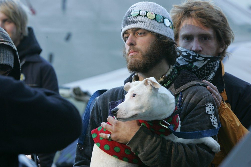 A man who bystanders say choked a dog at the Occupy SF encampment in Justin Herman Plaza was beat up by an angry mob Wednesday afternoon.