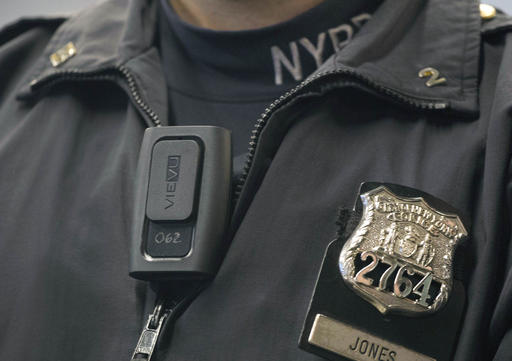 In this Dec. 3, 2014 file photo, New York Police Department officer Joshua Jones wears a VieVu body camera on his chest during a news conference in New York. (AP Photo/Mark Lennihan, File)